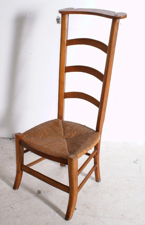 "20:  19th century ladder back rush seat chair. H: 38"" ."