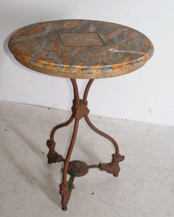 8: Iron table with faux marble painted top.