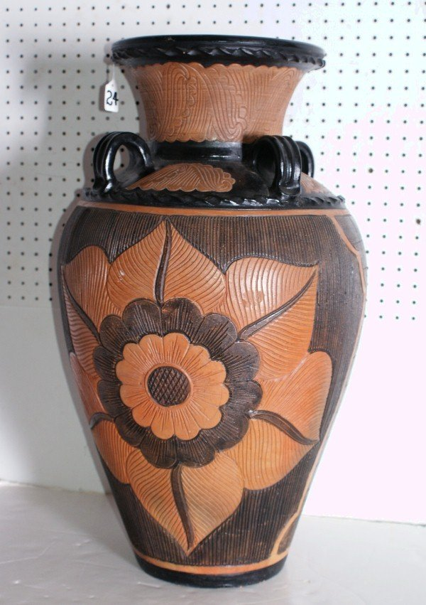 "24: Continental glazed terracotta olive jar. H: 27"""