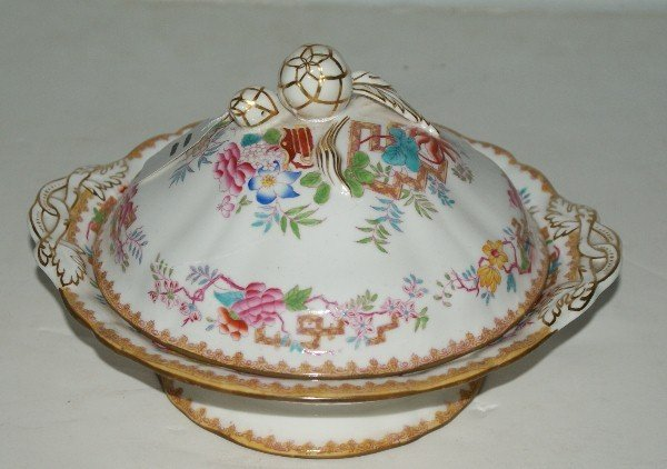 11: Minton porcelain entrée dish and cover. Diameter: 9