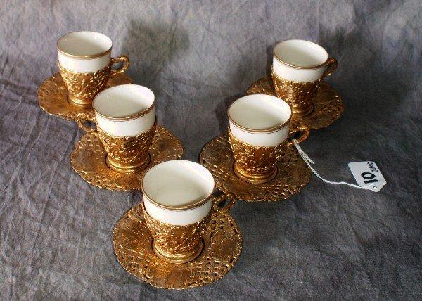 10: Set of five porcelain and gilt metal demitasse cups