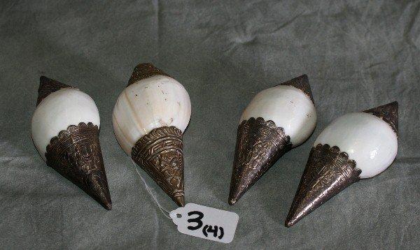 3: Four porclain and silver shells.