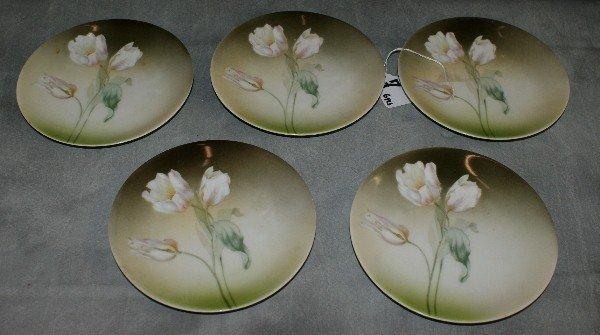 7: Five German porcelain hand painted plates.