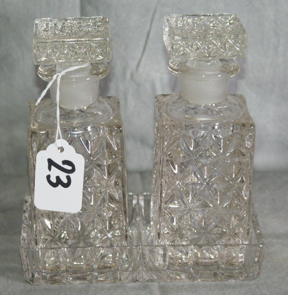 23: Glass perfume bottles in stand.