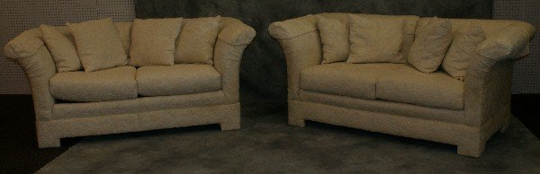 20: Pr of white upholstered love seats with down throw