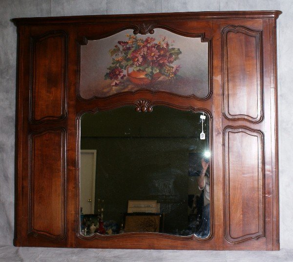 89: 19th C Trumeau mirror with a still life of flowers