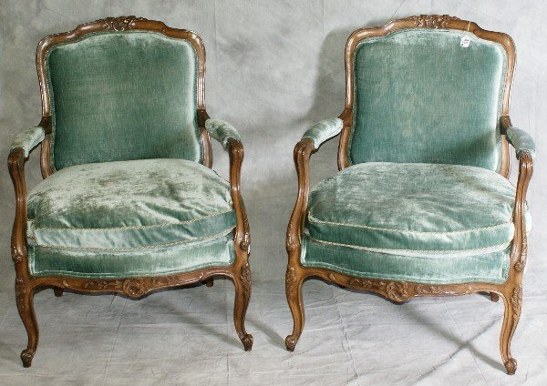 96: Pair of blue upholstered carved French arm chairs.