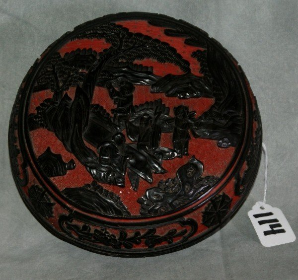114: Chinese red and black carved cinnabar covered box
