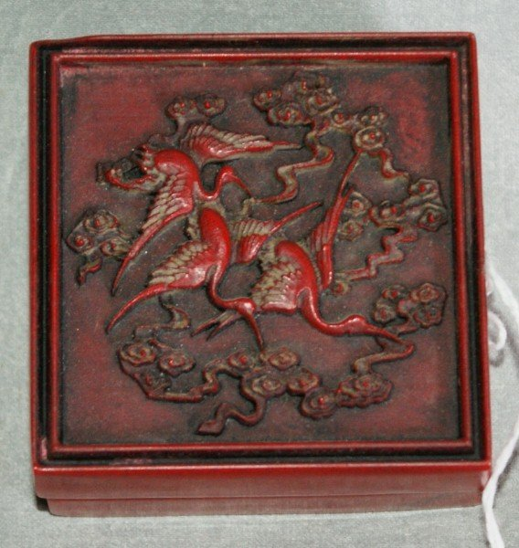 128: Chinese red scholars bor with a carved top and ins