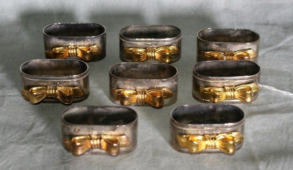 9: Eight silver plate and gold washed napkin holders.
