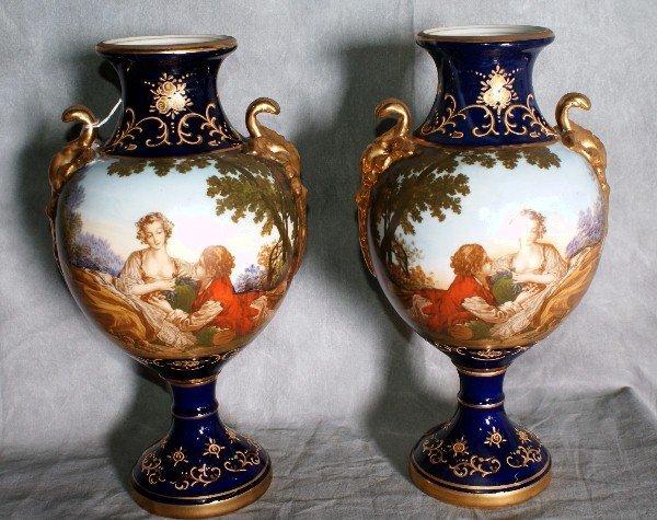 "12:  Pair sevres style porcelain vases. H:13.5""."