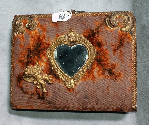 13:  Antique bronze and fabric photo book with photos.