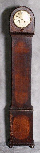 "18:  Oak grandmother clock. H:51"" W:9"" D:6""."