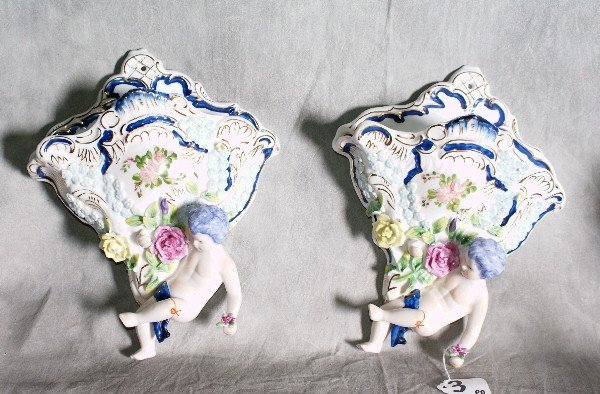 3:  Pair of porcelain painted figural hanging vases. H: