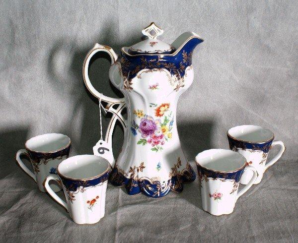 6:  5 piece porcelain painted tea set by Limoges. Teapo