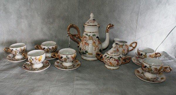 7:  15 piece Capodimonte porcelain teaset. Teapot H:10.