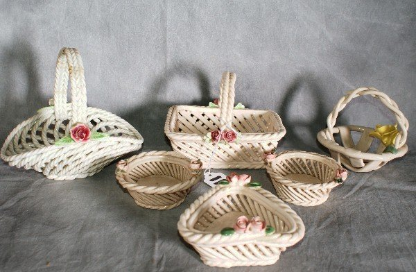 "11:  6 porcelain painted baskets. Tallest H:6""."