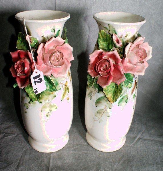 "12:  Pair of painted ceramic floral vases. H:12. 25""."