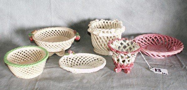 "13:  6 porcelain painted baskets. Tallest H:3. 5""."