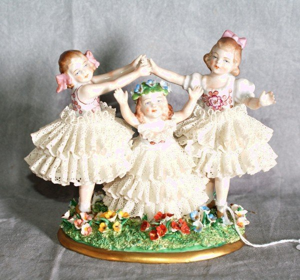 """15:  Dresden figural group of three girls. H:5. 25"""" L:6"""