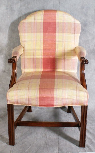 """18:  Mohogany upholsterd arm chair. H:40"""" W:25"""" D:25""""."""