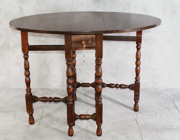 "19:  Mahogany drop leaf gate leg table. H:30"" L:32"" D:1"