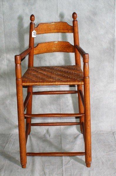 """22:  Antique oak childs chair. H:35"""" W:17"""" D:17""""."""