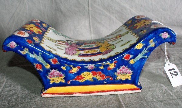 """12:  Chinese porcelain pillow. H:4"""" L:10"""" W:5""""."""