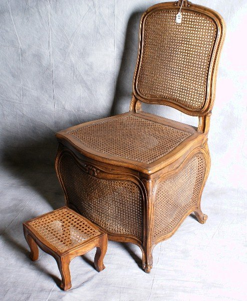 21: 19th C French cain portable commode chair with matc