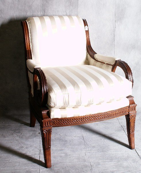 "6: Mahogany carved French arm chair. H:37"" W:28.5"" D:34"
