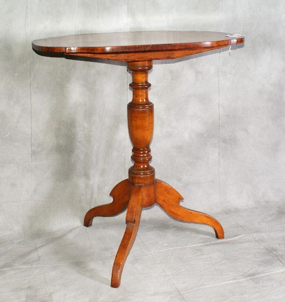 "9: 19th C tiger maple tilt top table. H:28"" L:26"" W:17."