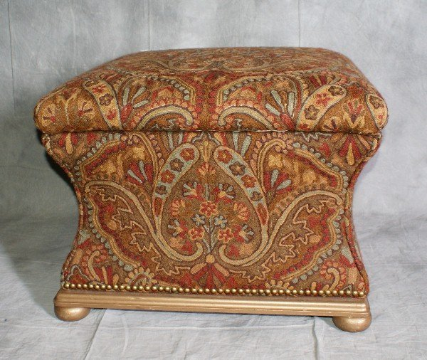 18: Upholstered ottoman that opens at top for storage.