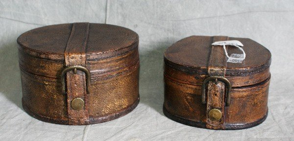 "19: 2 leather covered boxes. Largest H:4"" D:7"""