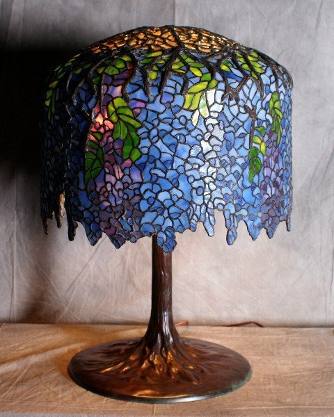 161: Large signed Tiffany table lamp With a tree trunk