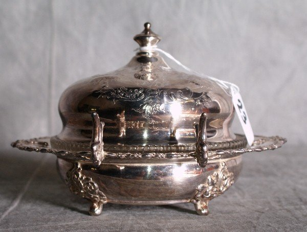 23:  American silver plate dome covered repousse butter