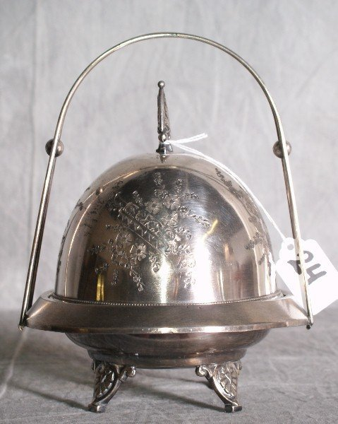24:  American silver plate basket form etched dome cove