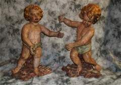 219: Pair 18th/19th C Italian carved wood putti figures