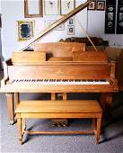 135E: Steinway piano with matching piano bench.