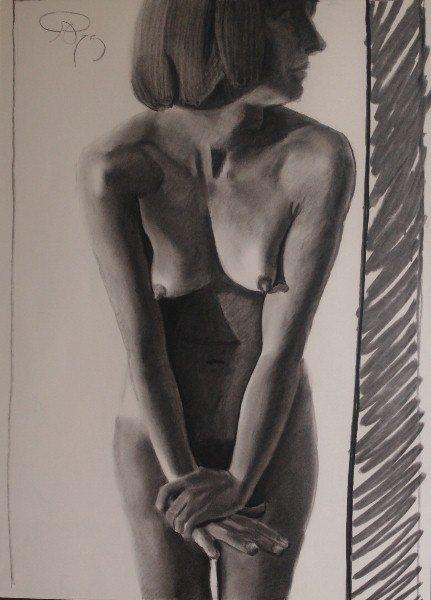 12: Framed charcoal of a nude signed upper left.