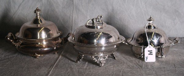14: Three American silver plate covered butter dishes.