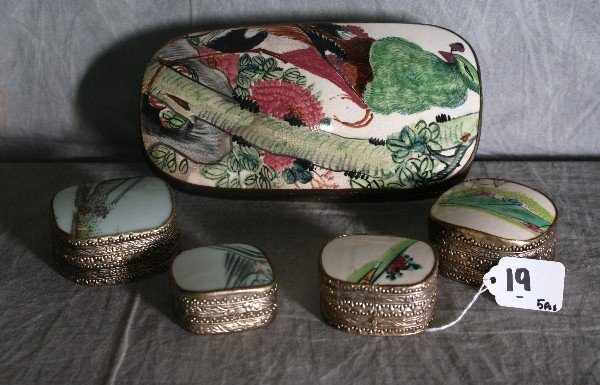19: Five Chinese silver and enamel covered boxes.