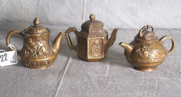 22: Three Chinese bronze teapots with chop marks on bot