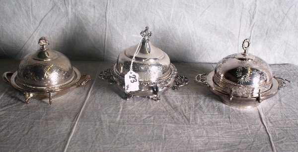 23: Three American silver plate covered butter dishes
