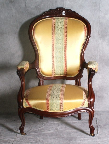 Victorian mahogany arm chair with Versace upholstery. H