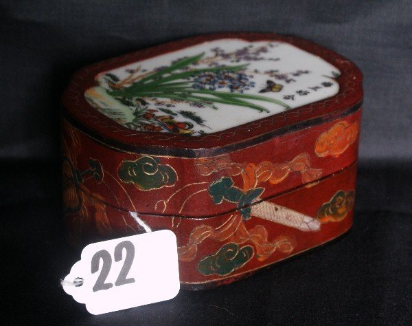 Chinese laquered box with porcelain plaque insert on to