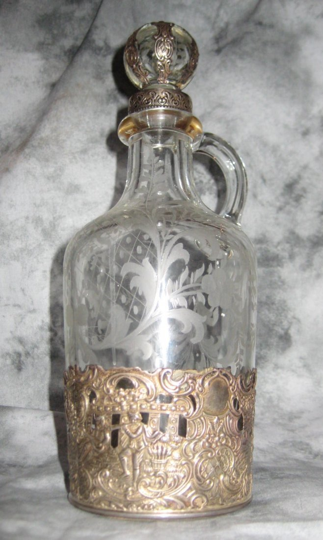 Dutch sterling silver and etched glass bottle and st