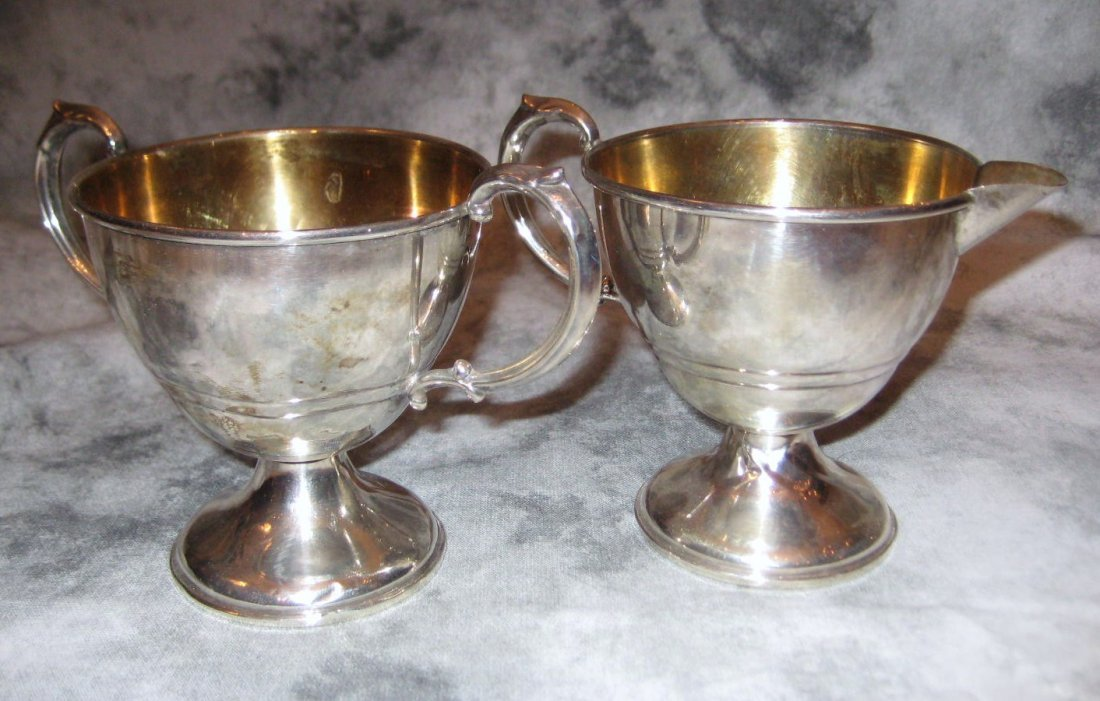 Pair of sterling silver weighted sugar and creamer.