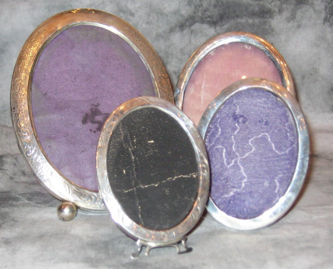 Four sterling silver oval picture frames, two floral en
