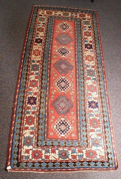 Antique Persian Kazak runner. 10'6 X 4'5