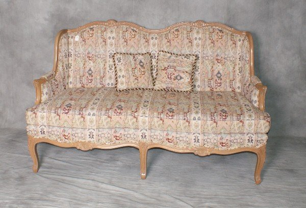 "Carved and upholstered wood settee. H:37. 5"" W:62"" D:3"